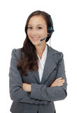 Sweet young woman wearing a headset Royalty Free Stock Images
