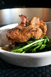 Sweetbreads over fresh greens Royalty Free Stock Photos
