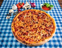 Sweetcorn and bean pizza with cheese royalty free stock photo