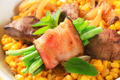Sweetcorn with fried chicken liver and green beans in bacon Royalty Free Stock Photos
