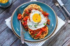 Sweetcorn pancakes with fried egg and chorizo salsa. Sweetcorn pancakes with fried egg and chorizo and red pepper salsa - high angle view stock image