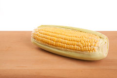 Sweetcorn on wooden table Royalty Free Stock Photos