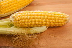 Sweetcorn on wooden table Royalty Free Stock Photography
