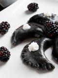 Sweeten pierogi with blackberries Stock Image