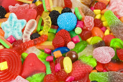 Sweetened assortment of multicolored candies. Close view of a collection of multicolored sweeties Stock Photos