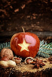 Sweetened Christmas Apple with Carved Star Royalty Free Stock Images