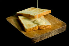 Sweetened condensed milk and breads Royalty Free Stock Image