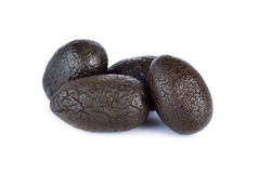 Sweetened pickle Chinese white olive or Chebulic Myrobalan on wh Stock Photos