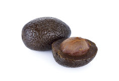 Sweetened pickle Chinese white olive or Chebulic Myrobalan on wh Stock Image