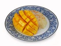 Sweetened sticky rice with ripe mango stock image