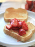 Sweetened strawberries on toast Stock Images