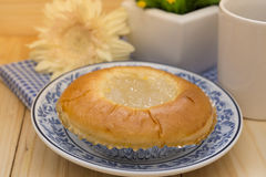 Sweetened toddy palm bun on plate with cup of coffee Stock Images