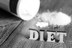 Sweetener tablet and sugar. Text diet wooden letters. Food royalty free stock images