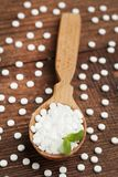 Sweetener tablets. In wooden scoop with mint leaf on wooden table Stock Photography