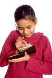 Sweetest reward. A girl counting some cash in a brown wallet Stock Image