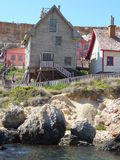 SWEETHAVEN. Old wooden fishing village houses and dwellings stock photos