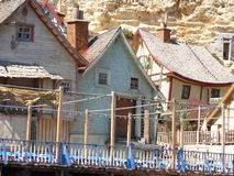 SWEETHAVEN. Old wooden fishing village houses and dwellings royalty free stock photography