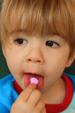 Sweetheart. My 2 1/2 year old son eating a sweetheart candy on Valentine's Day Royalty Free Stock Images