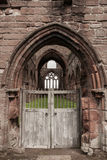 Sweetheart Abbey. Medieval archway of the Sweetheart Abbey ruin Royalty Free Stock Image