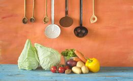 Sweetheart cabbage with kitchen utensils. Autumn cooking, good copy space Stock Images