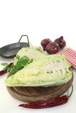 Sweetheart cabbage. A sliced sweetheart cabbage on a wooden board Stock Photos