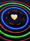 Sweetheart: centre of my world. An image of colored circles (orbits) centered on a gold locket symbolizing a sweetheart. An abstract image designed principally Stock Image