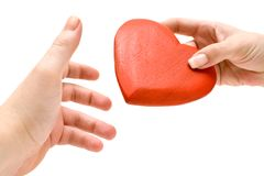 Sweethearts. Reaching for a womans heart. Isolated on a white background Stock Photography