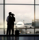 Sweethearts In Airport Royalty Free Stock Photos