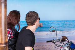 Sweethearts on a Motorcycle Looking at the Ocean Stock Photography
