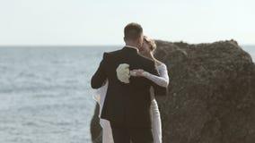 Sweethearts newlyweds dancing on the seaside near stock video footage