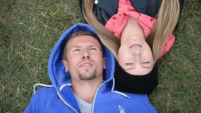 Sweethearts students lying on grass head to head stock video