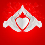 Sweethearts. White heart between two flying white doves Royalty Free Stock Photos
