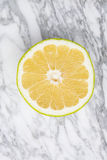 Sweetie, grapefruit on gray marble Royalty Free Stock Image
