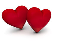 Sweetie Hearts. Couple of red hearts on white background with copy space Stock Photography