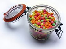 Sweetie jar. Old-fashioned jar filled with multicoloured sweets Stock Image