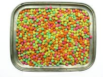 Sweetie tray. An old metal tray, filled with multicoloured sweeties Stock Photo