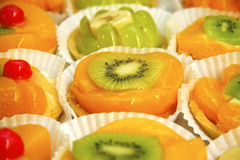 Sweeties. Canapes with peach, mandarine, kiwi and other fruits Royalty Free Stock Image