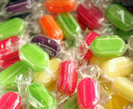 Sweeties. Different flavoured fruit sherbert sweets in their wrappers royalty free stock photography