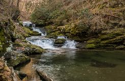 A sweetly cascading waterfall, southeastern Tennessee, USA. A sweetly cascading unnamed waterfall amidst winter`s bare branches, southeastern Tennessee, USA royalty free stock photo