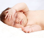 Sweetly sleeping baby. On the white blanket Royalty Free Stock Image