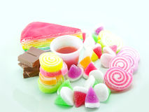 Sweetmeat on mint background. Various of sweetmeat on mint background Stock Photos