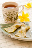 Sweetmeats and a cup of tea Stock Photography