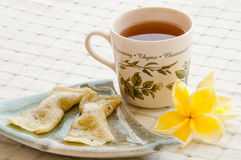 Sweetmeats and a cup of tea Royalty Free Stock Photo