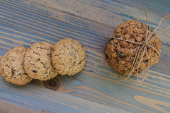 Sweetmeats. Two types of oatmeal cookies with sunflower seeds and raisins. Some related cord with bow, a second overlapping ends. View from above.  Perfect for a Royalty Free Stock Photos
