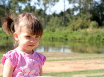 Sweetness and Light. Small girl in park stock images