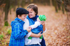 Sweetness. Mother with their children - teenager boy and newborn Royalty Free Stock Photography
