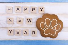 Sweetness for 2018 New Year. Happy New Year with sweet paw. Delicious congratulations royalty free stock photography