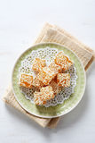 Sweetness with sesame on a plate Royalty Free Stock Photos