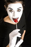 Sweetoothed Mime Sucks on Red Candy Sucker Royalty Free Stock Photography