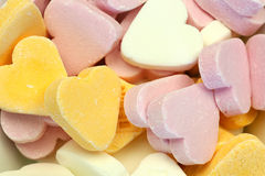 Sweets. Heart shaped colorful sweets on a white background Royalty Free Stock Images